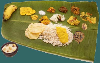 Serving Onam Sadya,Onasadhya,Onam Feast,vegetarian feast,tender banana plantain leaves,Plastic leaf,Pappadam,Rice,parippu curry,Ghee,Sambar,Kalan,Rasam,Pulisseri,buttermilk,Adapradhaman