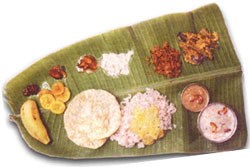 Pappad or Pappadum, banana (can be 'Rasakadali', 'Poovan', 'Palayankodan'). - Salt, banana wafers, sarkarapuratti fries, ginger, lime and mango pickles, 'vellarika', 'pavakka', 'beetroot' and 'ulli kitchadi'. 'Kitchadi' made of pineapple and banana splits or of grapes and apple, 'cabbage thoran' or thoran made of beans and avial, bread and green peas mix 'thoran'', kootucurry, 'parippu curry, ghee, Sambhar, Rasam, butter milk, curd, adaprathaman Payasam, erissery,